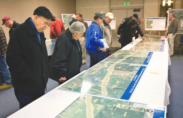 Bruce and Colleen Bumgarner, left, look at maps of proposed routes for the U.S. Highway 95 Thorncreek Road to Moscow Project during an Idaho Transportation Department hearing at the Best Western Plus University Inn in Moscow on Wednesday (Moscow-Pullman Daily News/Geoff Crimmins photo).