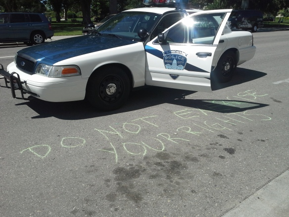 Stop the Frack Attack, Idaho! in Boise, drawing two cop cars of repression (Helen Yost photo)