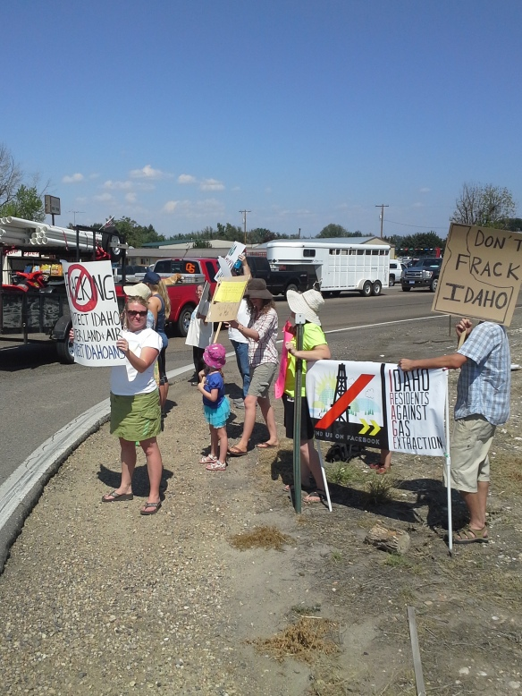 Protesters from across the state and country chant and wave fracking/drilling protest signs at the high-traffic corner of Highways 95 and 30 near Interstate 84 Exit 3 in southwestern Idaho.