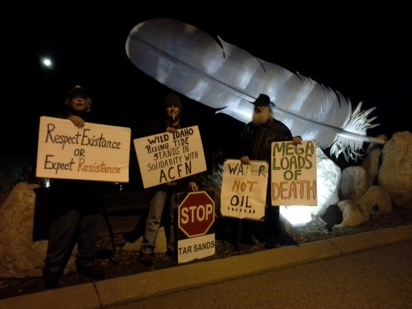 Occupy Bellingham and Spokane Rising Tide protesters of a tar sands megaload moving on Northwest Boulevard in Coeur d'Alene, Idaho, on Monday, November 11