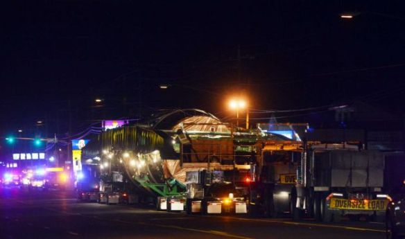 On Monday, December 2, 2013, a megaload slowly moves south on Highway 395 through Hermiston, Oregon.  The transport rig carries a 450-ton piece of equipment bound for a tar sands development site in western Canada (Associated Press/E.J. Harris photo).