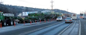 Monday morning traffic moves past the megaload, parked at the ODOT weigh station on the west edge of John Day (Blue Mountain Eagle/Scotta Callister photo).
