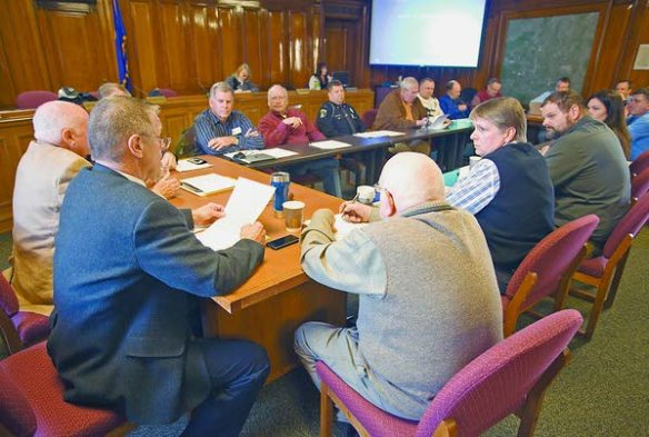 Moscow Mayor Bill Lambert, left, talks on Wednesday during a workshop at Moscow City Hall, held to learn more about oversized loads that Mammoet USA South has proposed shipping up U.S. Highway 95 from Lewiston (Moscow-Pullman Daily News/Geoff Crimmins photo).